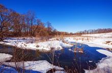 depositphotos_65778177-stock-photo-forest-river-with-snow-at